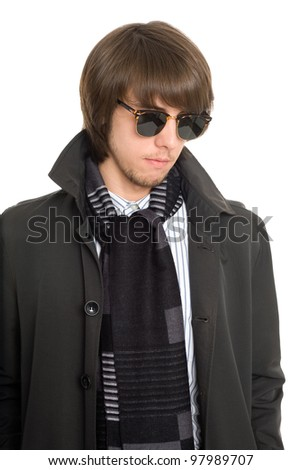 Young man in a raincoat looking down. - stock photo