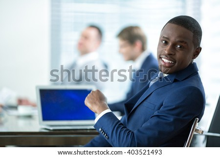 Young man in a suit in office - stock photo