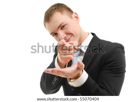 Young man in a suite pointing at camera. Focused on arms.  Isolated over white. - stock photo