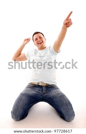 young man in a winner pose - stock photo