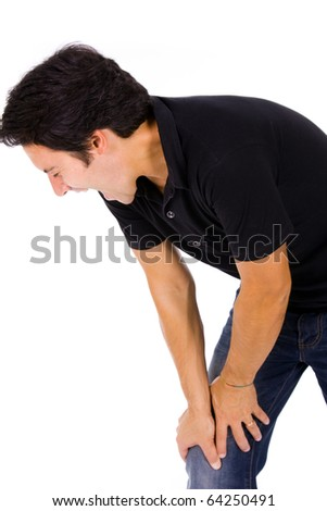 Young man in agony with knee pain. Isolated on white - stock photo