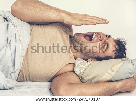 Young man  in bed , trying to sleep - stock photo