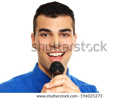 Young man in blue shirt singing into the microphone - stock photo