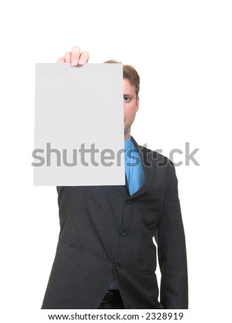 Young man in business suite showing a sheet of paper isolated on white - stock photo