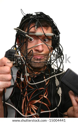 young man in cable chaos isolated on white - stock photo