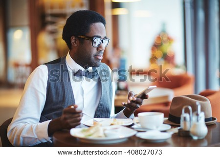 Young man in cafe - stock photo