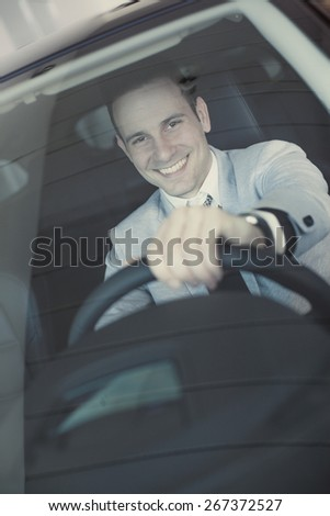 young man in car - stock photo