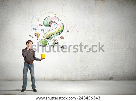 Young man in casual and question marks from bucket - stock photo