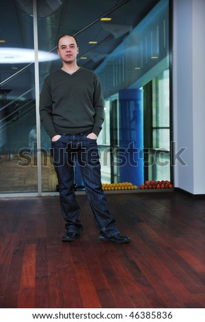 young man in casual clothing posing indoor - stock photo