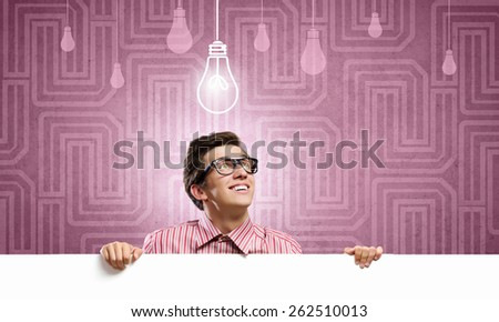 Young man in casual holding white blank banner - stock photo