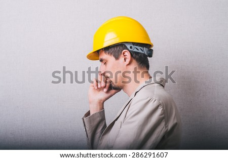 Young man in construction helmet having depression - stock photo