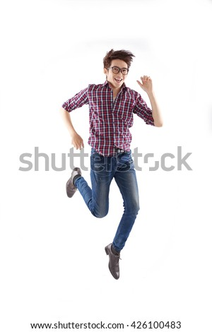 Young man in glasses running, isolated on white - stock photo