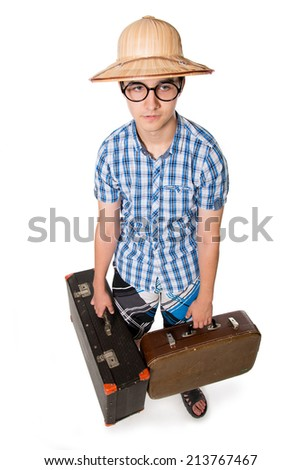 Young man in glasses with two bags ready to travel. The stereotype of a foolish novice traveler. Portrait of a traveler in a full-length isolated on white background - stock photo