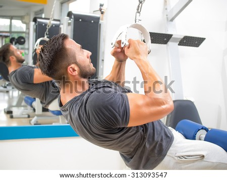 Young man in Gym - stock photo