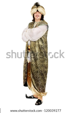 Young man in oriental costume. Isolated on white - stock photo