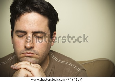 Young man in prayer - stock photo