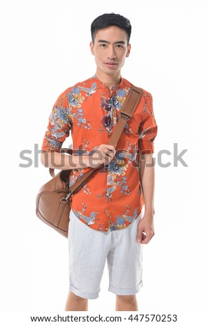 Young man in shorts with bag standing on white background - stock photo