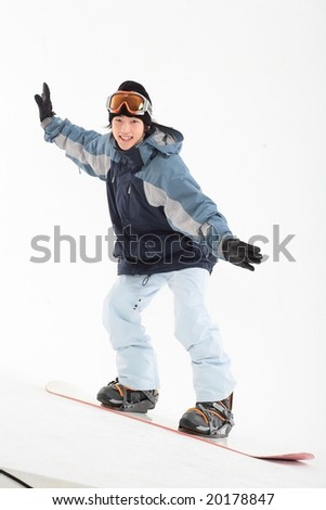 Young Man in Snowboard - stock photo