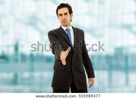 young man in suit offering to shake the hand - stock photo