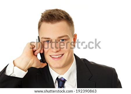 Young man in suit talks into the mobile phone  - stock photo