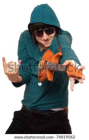 Young man in sunglasses with a little guitar - stock photo