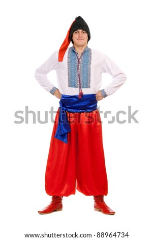 Young man in the Ukrainian national costume. Isolated on white - stock photo