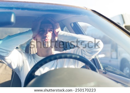 young man in traffic congestion - stock photo