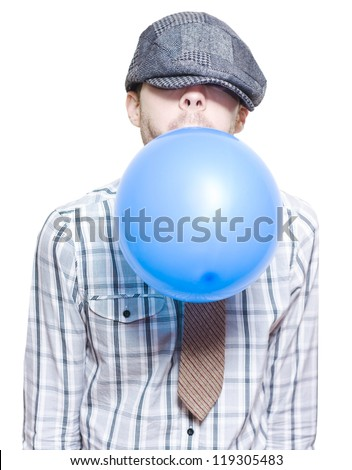 Young Man In Vintage Outfit Blowing Up A Blue New Years Eve Party Balloon On White Background - stock photo