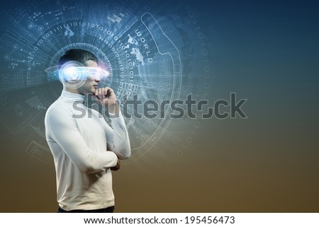 Young man in white against blue background with hologram around head - stock photo