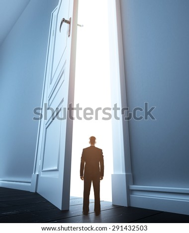 young man in white room with open doors - stock photo