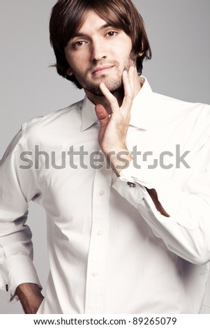 young man in white shirt portrait - stock photo