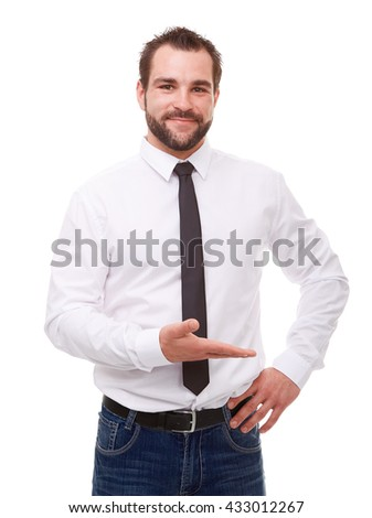 Young man in white shirt showing empty copyspace - stock photo