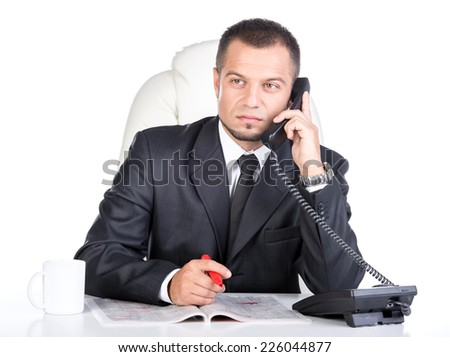 Young man is looking for a job in the newspaper and calling. - stock photo