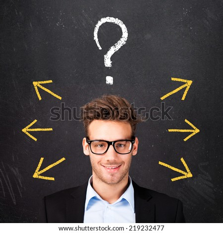 young man is lost in different options - stock photo