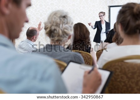 Young man is not interested about conference  - stock photo