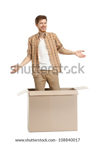 Young man is surprised why he is inside the box, isolated, white background - stock photo