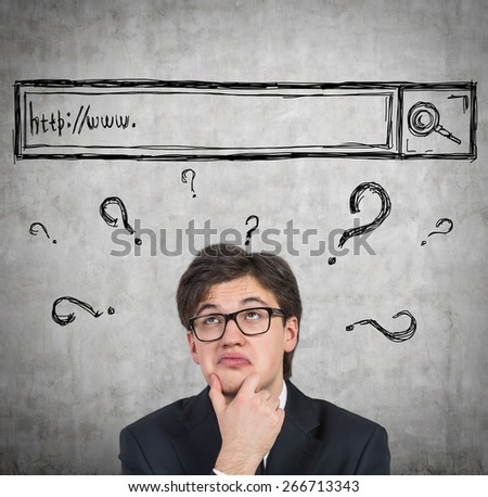 Young man is trying to find some answers in the internet. - stock photo