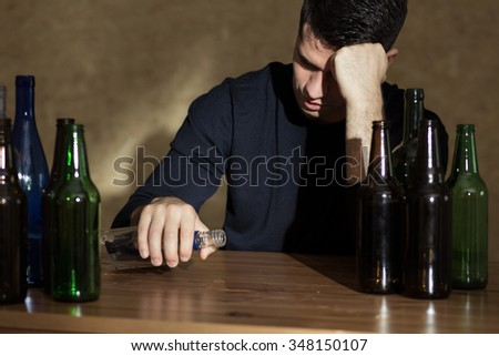 Young man is very drunk and alone  - stock photo