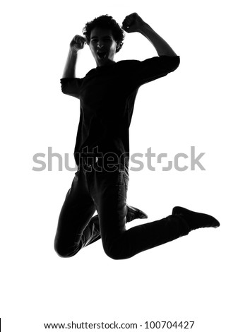 young man jumping happy silhouette in studio isolated on white background - stock photo