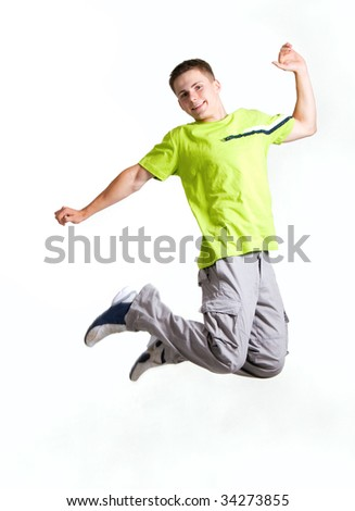 Young man jumping, isolated on white - stock photo