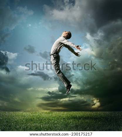 Young man jumping up to Sky - stock photo
