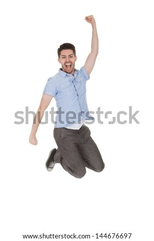 Young Man Jumping With Arms Raised Over White Background - stock photo