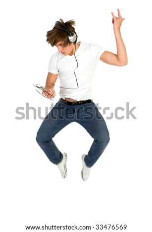 Young man jumping with MP3 player - stock photo