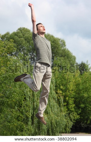 young man jumps outdoor - stock photo