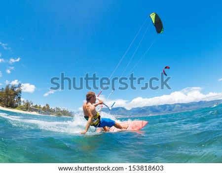 Young Man KiteBoarding, Fun in the ocean, Extreme Sport Kitesurfing - stock photo