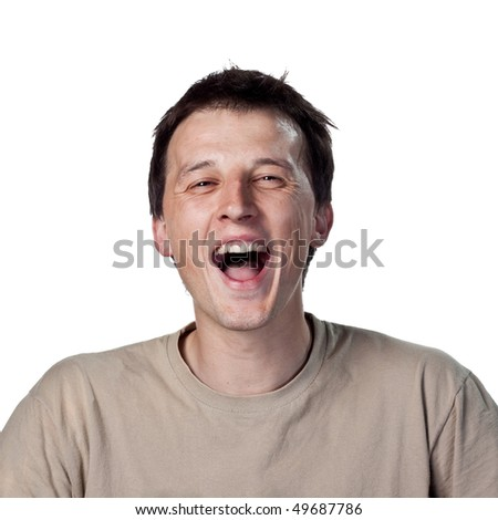 Young man laughing - stock photo