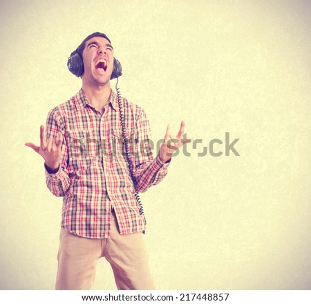 young man listen to music - stock photo