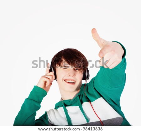 Young man listening music in studio - stock photo