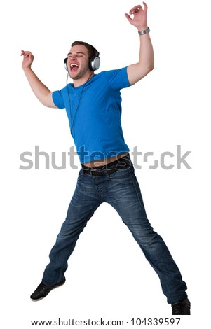 Young Man Listening to music and jumping in the air - stock photo