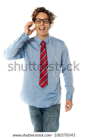 Young man listening to music isolated - stock photo